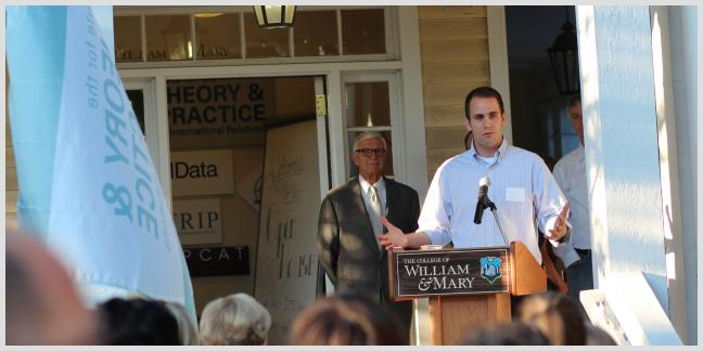 From left to right, Taylor Reveley, President of the College of William & Mary, stands while Brad Parks, Executive Director of AidData, speaks at an AidData/ITPIR Open House in 2013. Photo by AidData, all rights reserved.