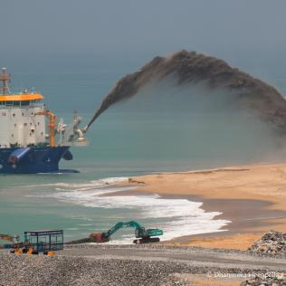New land emerges from the sea at the US$1.4 billion Chinese-backed Port City project near Sri Lanka's main port, part of Beijing's ambitious global expansion of investment and aid. Photo by Dhammika Heenpella, licensed under (CC BY-NC 2.0).