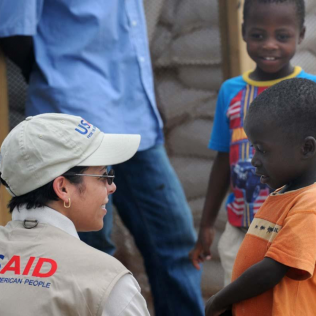 Alexandra Riboul with USAID talks with children at Tabarre Issa Emergency Relocation Camp in Haiti on June 7, 2010. Photo by Kendra Helmer/USAID, licensed under CC BY-NC-ND 2.0.