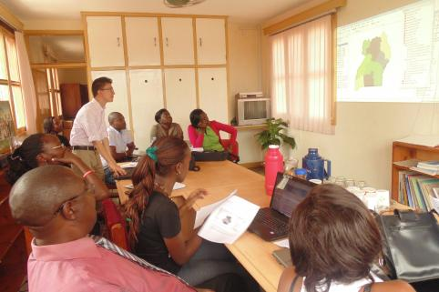 Daniel Chapman conducts a GIS training at Uganda Debt Network