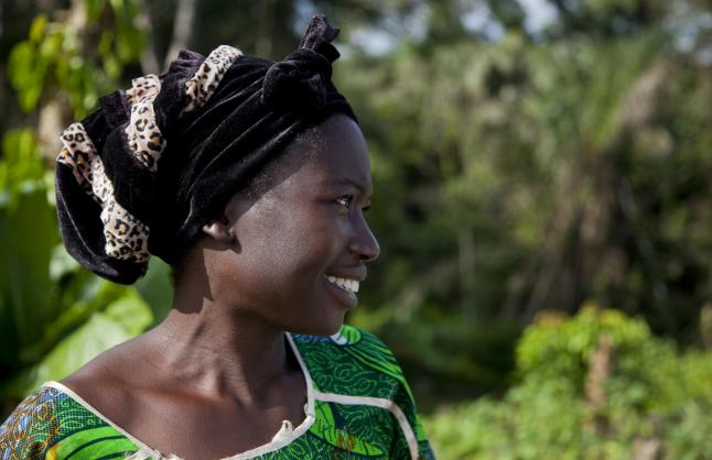 Martha Togdbba of Kpaytno, Liberia, grows vegetables, including tomatoes and chili peppers