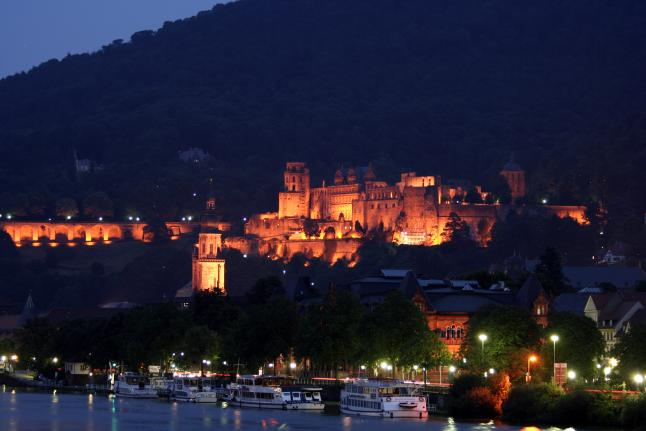Heidelberg Castle in Heidelberg, Germany, lights up on a warm summer night. Photo by Raul Lieberwith, licensed under (CC BY-NC-ND 2.0).