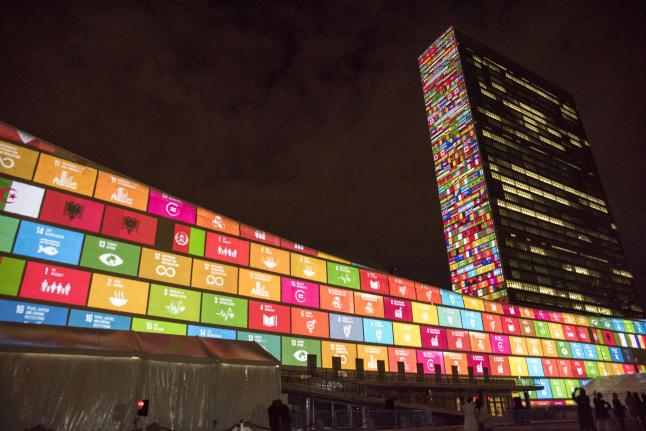 A lightshow to launch the UN's Sustainable Development Goals is seen on the facades of the General Assembly and Secretariat buildings in New York City on September 22nd, 2015. Photo by UN Photo/Cia Pak.