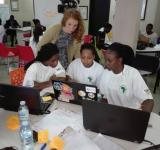 AidData Summer Fellow Allison Bowers works to answer a team's questions at the 2017 RAN-AidData GIS Hackathon. Photo by Mbabani Allan.
