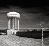 The Flint Water Plant tower in Flint, MI. The Flint water crisis is ongoing. Photo by George Thomas, licensed under (CC BY-NC-ND 2.0).